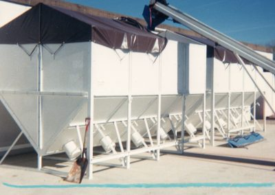 Fertilizer Bins with discharges chutes for easy access with a belt loader
