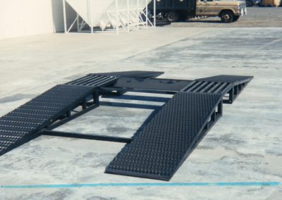 Belly dump trailer Drive Over Ramps for discharging fertilizer onto belt loaders